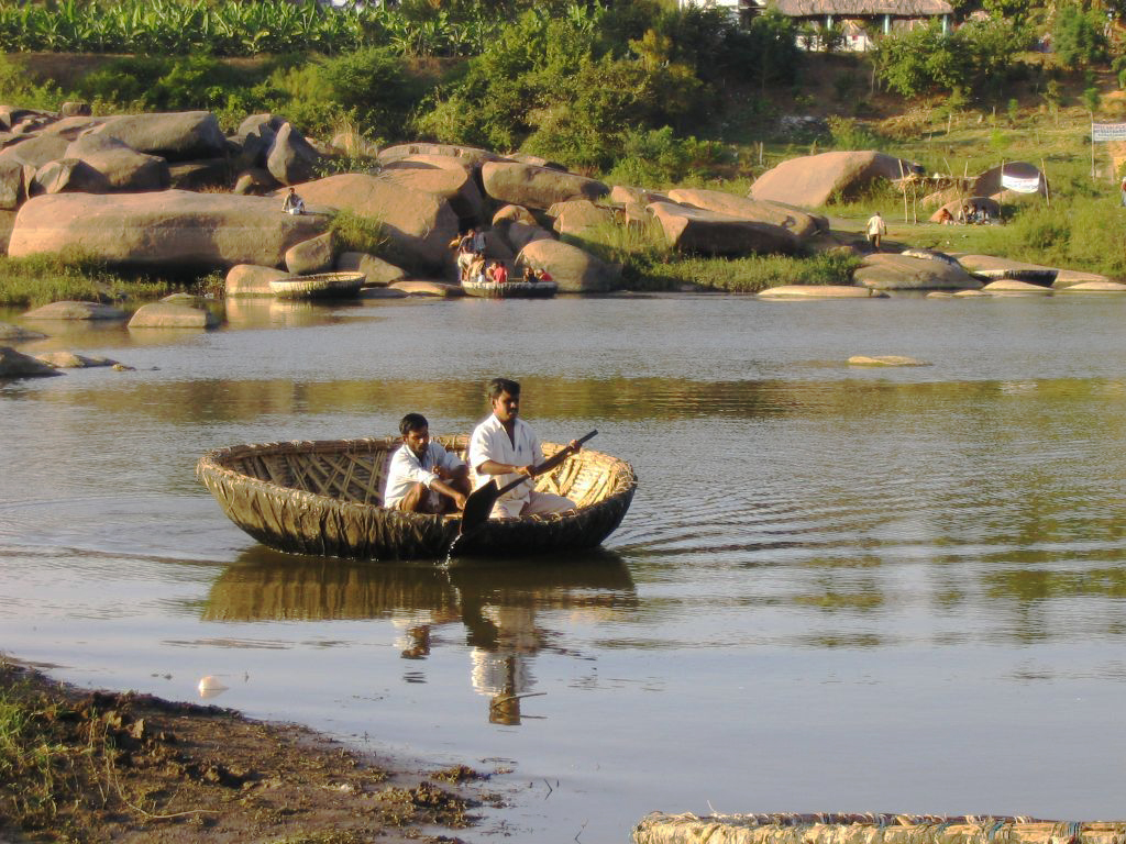 Coracle ride in the waters Cauveri River in Tamil Nadu